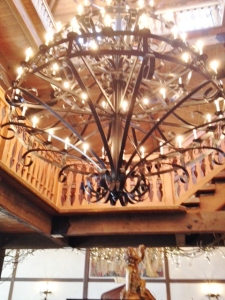 Dramatic chandelier over the central bar