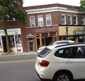 The Crooked Ladder Brewery is part of the scene on Main Street in Riverhead.