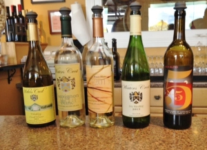 The lineup so far, with the Charles Demuth-inspired label on the far right.