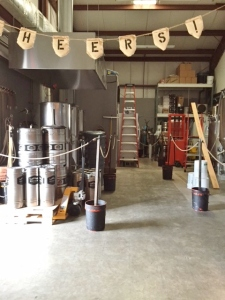 The view from the tasting room into the brewery.