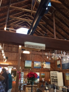 You can see some of the paintings for sale, and also a sign on the beam that never fails to amuse my husband.