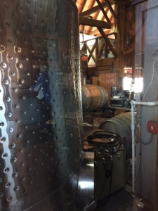Through a window in the tasting room you can peep in to see the vats.