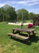 Picnic tables expand the space in the summer.